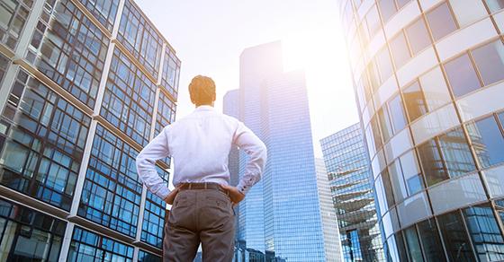 Man looking at office buildings