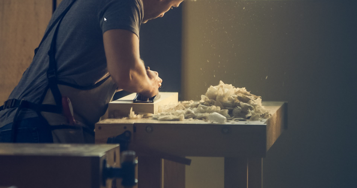 Photo of woodworker in action.