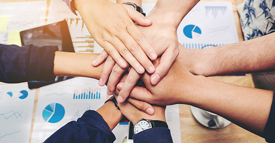 Business teamwork - joining hands