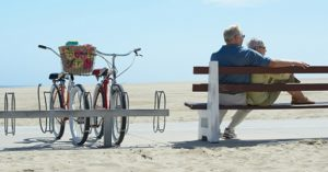 Older couple on a bench at a beach