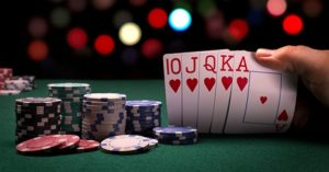 Poker player looking at hand at poker table