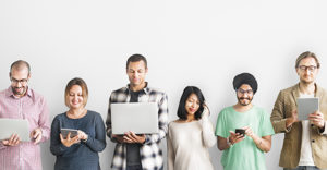 Diverse group of people holding different mobile devices